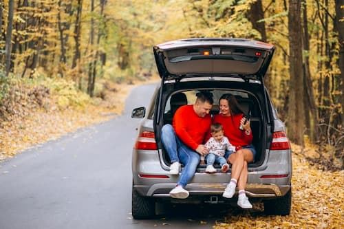 A family in a car. Glad to have found good Auto insruance quote.
