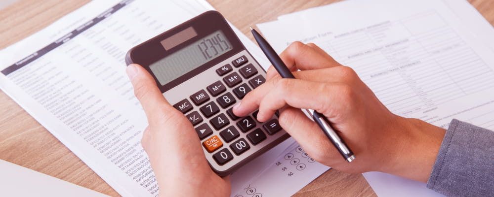 Calculator a Medicare Plan and papers on white table